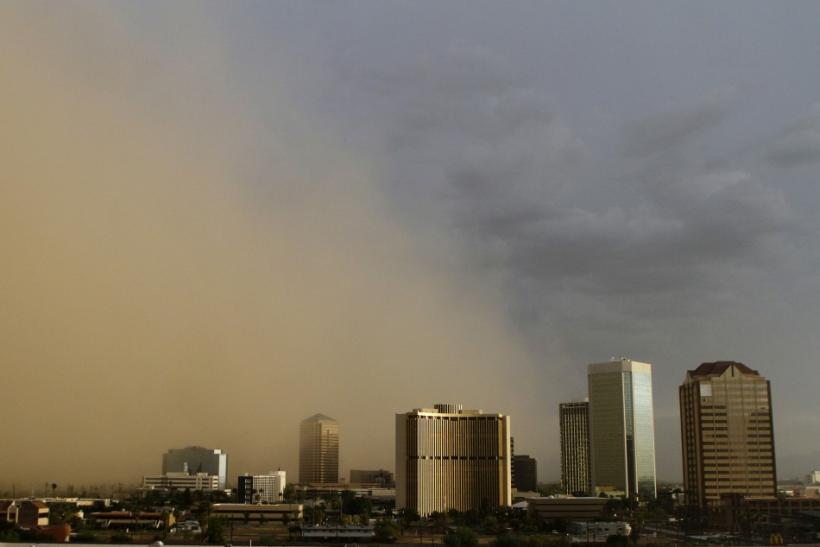 A dust storm surrounds high rise buildings in