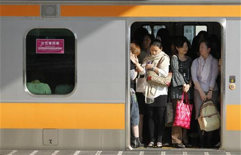 """Women board a """"women only"""" passenger train during morning rush hours in Tokyo"""