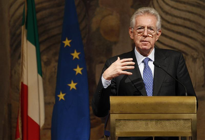 Newly appointed Prime Minister Mario Monti gestures during a news conference at Giustiniani Palace in Rome