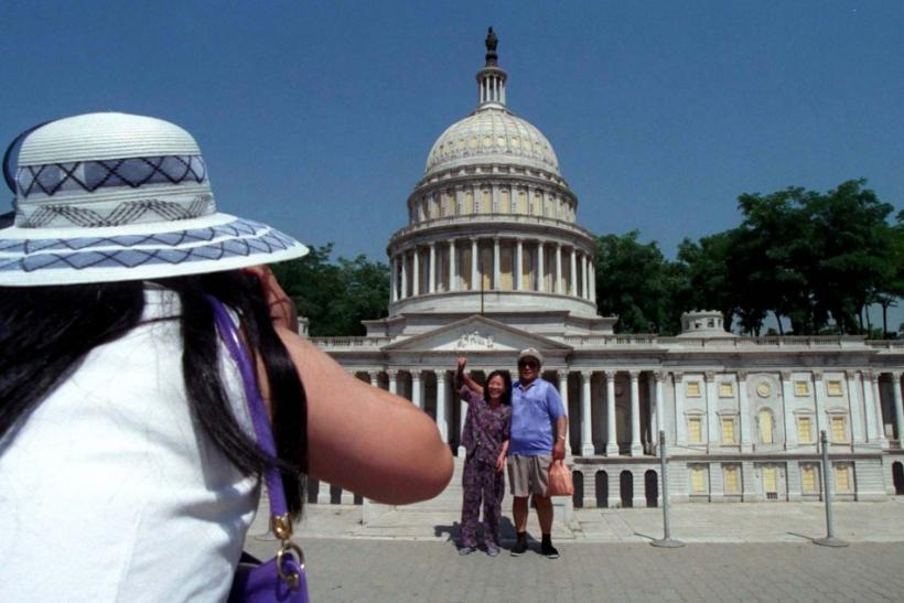Chinese Tourists Take Photos in front of Capital Building Replica in