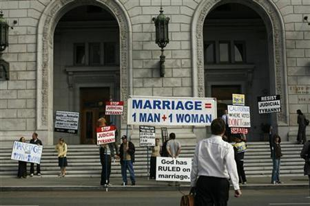 Supporters of California's Proposition 8 ban on gay marriage protest outside the California Supreme Court in San Francisco, California before a hearing on the initiative September 6, 2011.