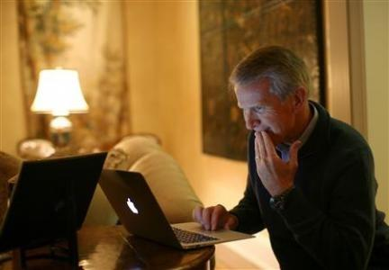 Hewlett Packard executive chairman and Kleiner Perkins managing partner Ray Lane works on his computer at his home in Atherton, California November 11, 2011.
