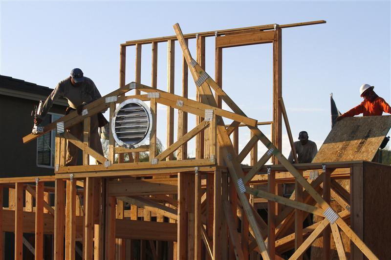 Workers construct the roof of a house in Phoenix