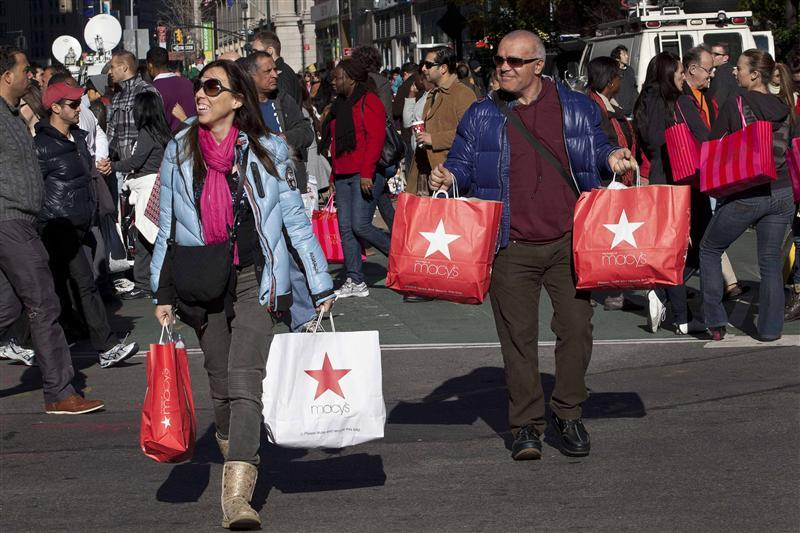 Black Friday shoppers cross 34th Street outside Macy's in Herald Square in New York