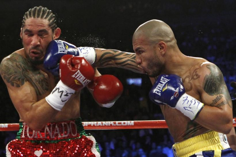 Miguel Cotto lands a right hand to the head of Antonio Margarito during their WBA Junior Middleweight Championship boxing match in New York