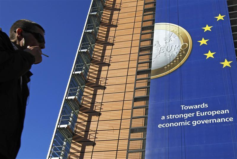 A banner featuring a Euro coin is seen on the European Commission headquarters building. The European Commission approved J&J's purchase of Synthes Inc. on Thursday.