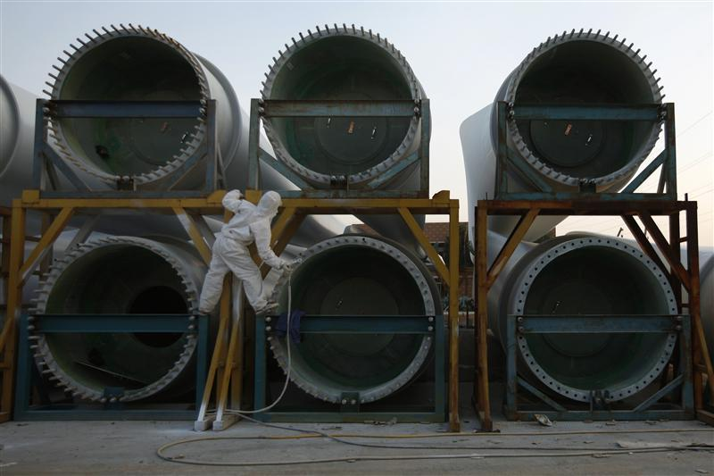 A worker paints wind turbines at China Ming Yang Wind Power Zhongshan Ming Yang electric factory in Zhongshan, southern Chinese province of Guangdong