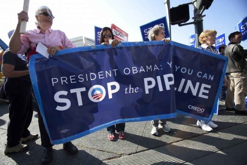 Demonstrators rally against the controversial Keystone XL oil pipeline outside President Barack Obama's fundraiser at the W Hotel in San Francisco