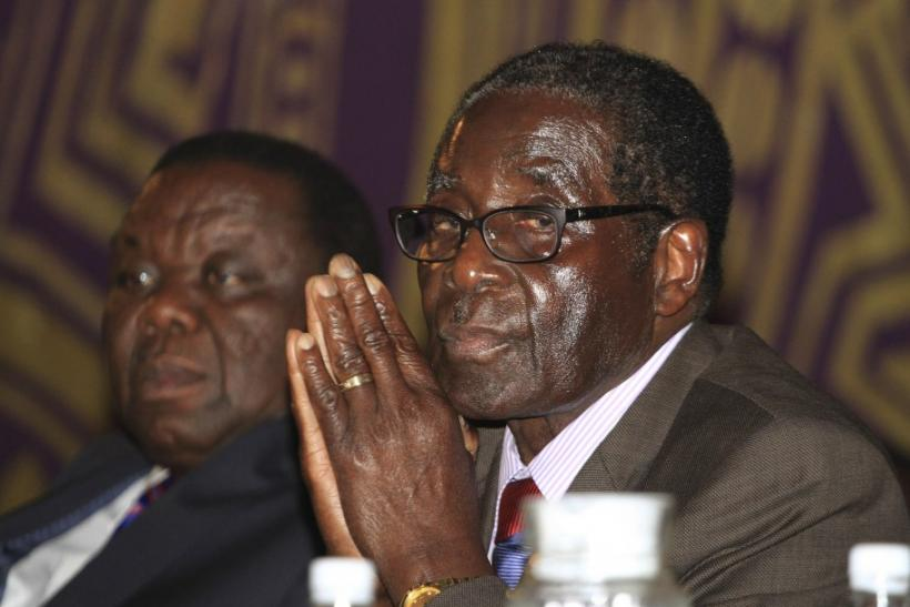 Zimbabwe's President Mugabe and Prime Minister Tsvangirai attend a joint meeting of senior members of their respective parties to discuss political violence, in Harare