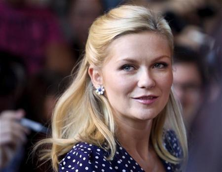 Actor Kirsten Dunst arrives at the gala premier of the movie Melancholia outside the Ryerson Theatre, at the 36th Toronto International Film Festival in Toronto