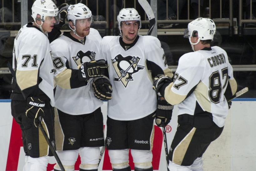 Pittsburgh Penguins Malkin, Niskanen and Crosby congratulate Neal after he scored against Rangers in New York