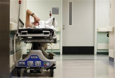 A patient waits in the hallway for a room to open up in the emergency room at a hospital in Houston, Texas