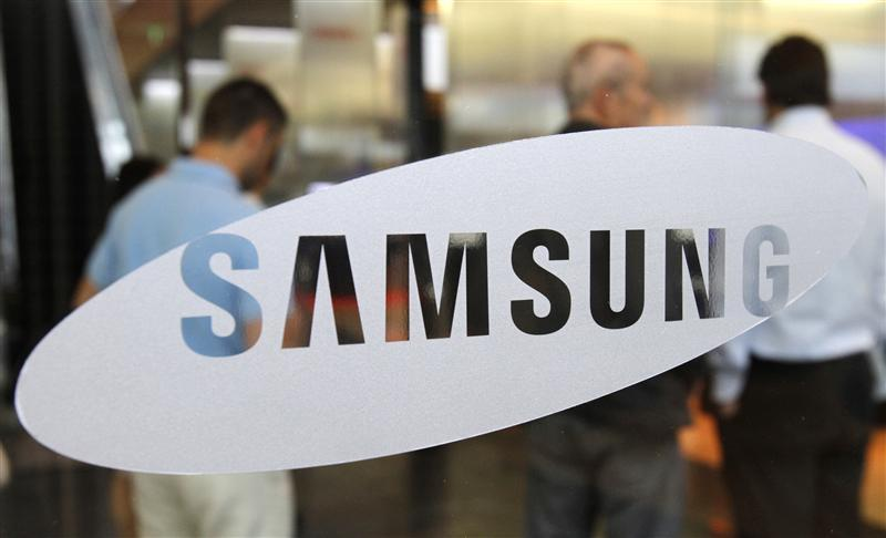 Foreign visitors look around at a showroom displaying Samsung Electronics' products at the company's headquarters in Seoul
