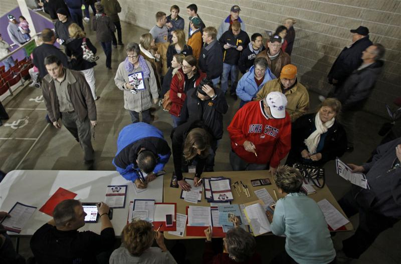 Caucus goers arrive and sign in for the 2012 Iowa Caucus at the UNI Dome on the campus of the University of Northern Iowa in Cedar Falls