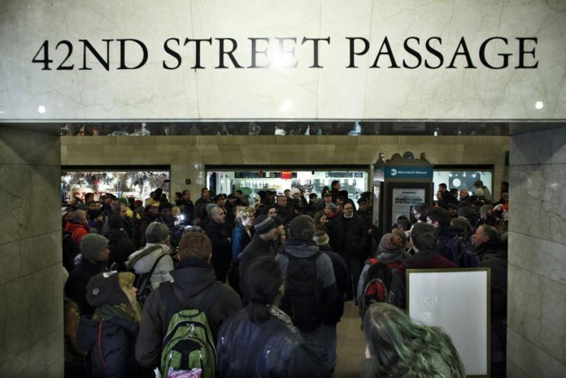 Protesters affiliated with the Occupy Wall Street movement hold a protest inside of Grand Central Station in New York