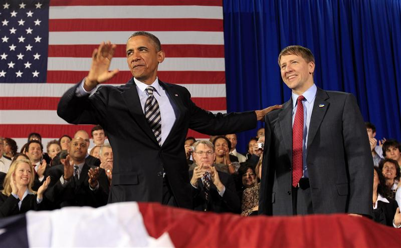 U.S. President Obama puts hand on shoulder of Cordray during trip to Cleveland