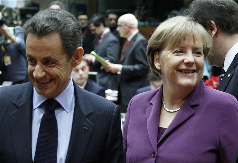 France's President Sarkozy talks with Germany's Chancellor Merkel at a European Union summit in Brussels