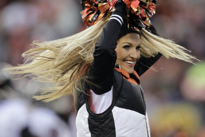 A Cincinnati Bengals cheerleader cheers for the team against the Baltimore Ravens during the first half of play in their NFL football game at Paul Brown Stadium in Cincinnati, Ohio, January 1, 2012