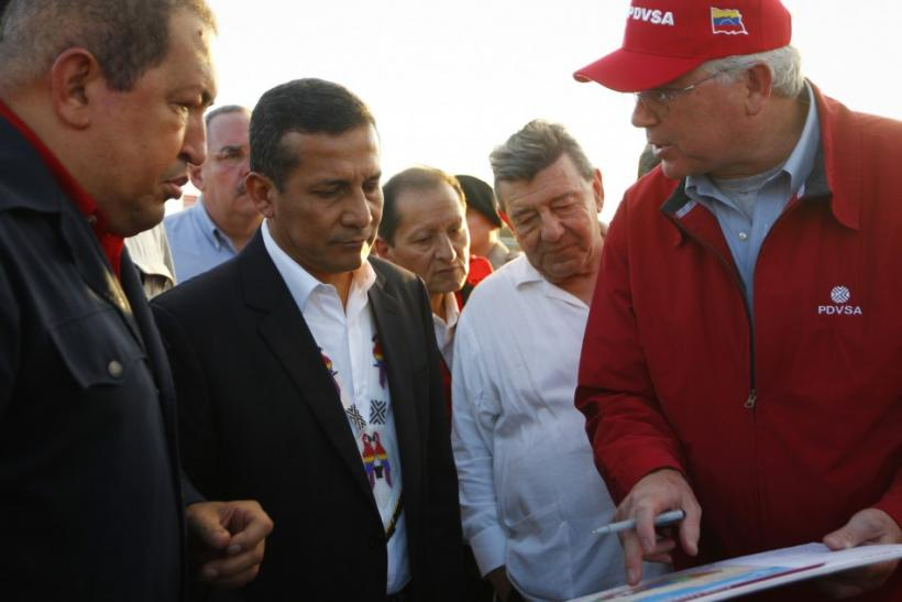 Venezuela's President Hugo Chavez (L) and Peru's President Ollanta Humala (2nd L) talk to Venezuela's Oil Minister Rafael Ramirez (R) during a visit to a facility at the oil rich Orinoco's belt near southern Venezuela's city of Pu