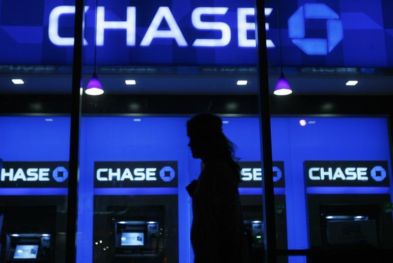 A woman walks past a JP Morgan Chase bank branch in New York