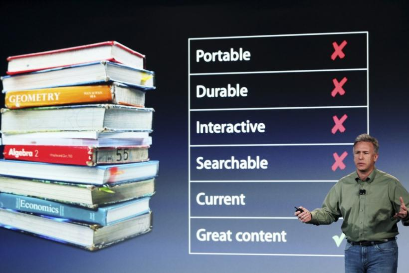 Apple Marketing chief Phil Schiller speaks during a news conference introducing a digital textbook service in New York