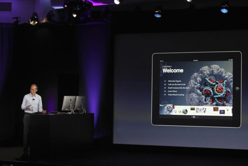 Apple's Vice President for Productivity Applications Roger Rosner shows a video during a news conference introducing a digital textbook service in New York