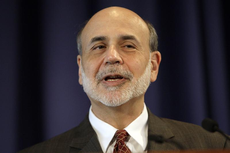 Federal Reserve Chairman Ben Bernanke delivers opening remarks at a conference in Washington