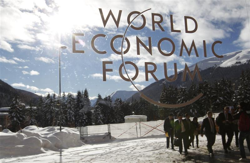 Visitors are reflected in window of the congress center, venue of the World Economic Forum (WEF) in Davos