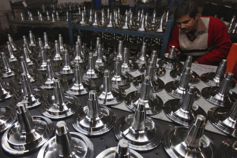 A worker performs a quality test on automobile parts at a factory in Ludhiana, in the northern Indian state of Punjab on Jan. 18, 2012.