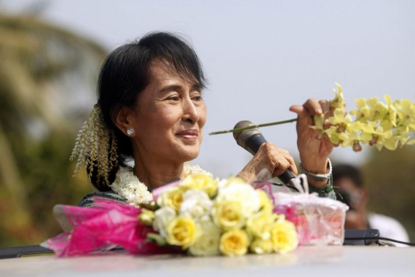 Myanmar opposition leader Aung San Suu Kyi speaks to supporters from a vehicle at Yae Phyu village in Dawei township January 29, 2012.
