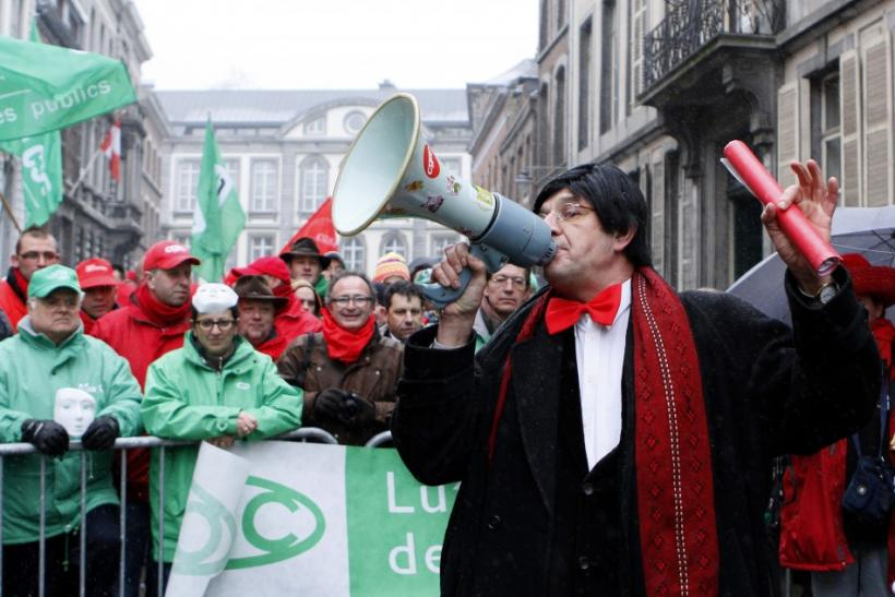 A man dressed as Prime Minister Elio Di Rupo delivers a speech as Belgian workers stage a protest in front Di Rupo's house during a national 24-hour general strike