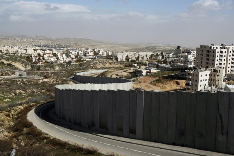 Section of controversial Israeli barrier is seen between Shuafat refugee camp, in West Bank near Jerusalem, and Pisgat Zeev, in area Israel annexed to Jerusalem after capturing it in 1967 Middle East war