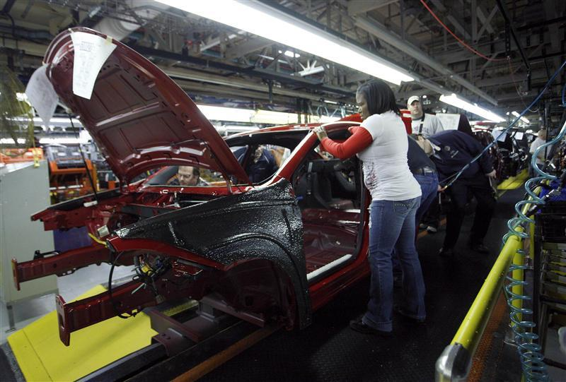 Workers assemble a pre-production 2013 Dodge Dart during a tour of the Chrysler Belvidere Assembly plant in Belvidere