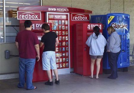 Customers rent DVD movies from a redbox video kiosk in Burbank, California, May 8, 2011.