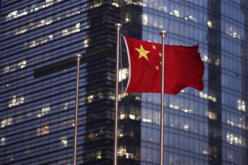 The Chinese national flag is seen in the financial district of Pudong in Shanghai