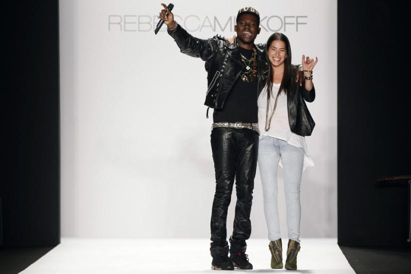 Designer Rebecca Minkoff smiles and waves with a musician after presenting her Fall/Winter 2012 collection during New York Fashion Week February 10, 2012.