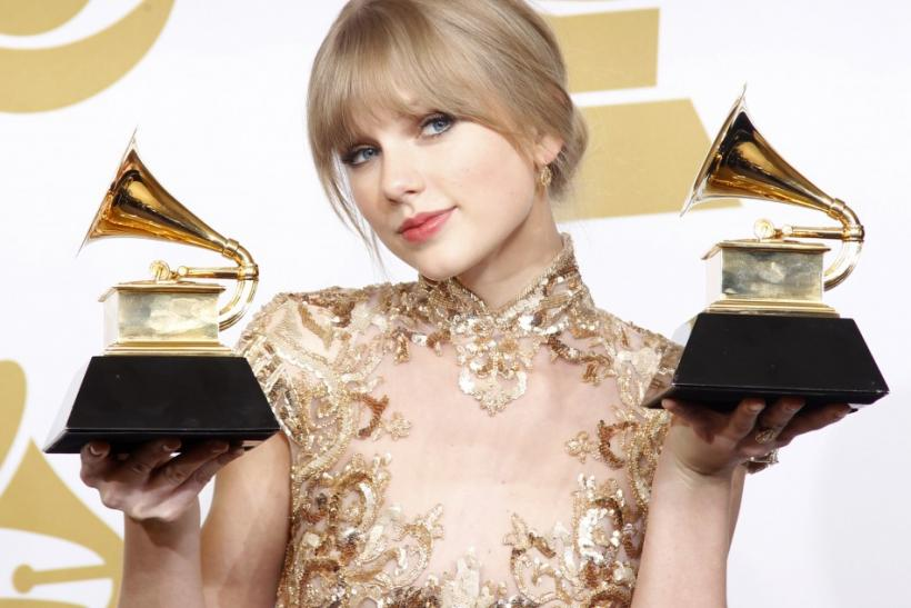 """Singer Taylor Swift holds her Grammys for Best Country Song and Best Country Solo Performance (""""Mean"""") at the 54th annual Grammy Awards in Los Angeles, California"""