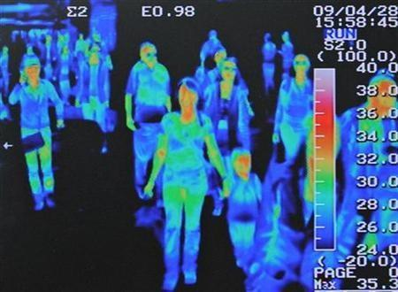 A thermal scanner shows the heat signature of passengers from an international flight arriving at Incheon airport, west of Seoul, April 28, 2009.