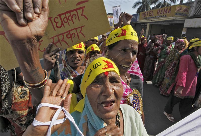 Local activists attend a demonstration to mark the 25th anniversary of the Bhopal gas disaster in Bhopal