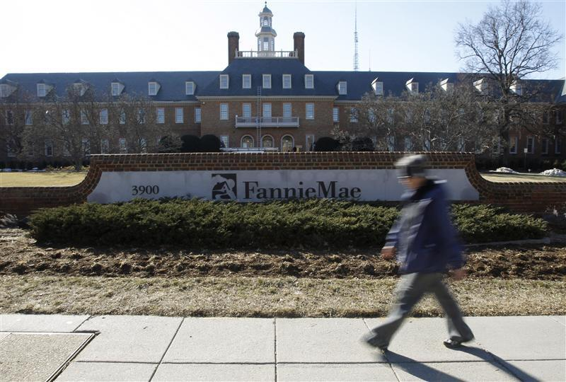 A woman walks past the Fannie Mae headquarters in Washington