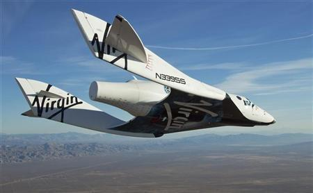 The Virgin Galactic SpaceShip2 (VSS Enterprise) glides toward Earth on its first test flight after being released from its WhiteKnight2 (VMS Eve) mothership over Mojave, California October 10, 2010. The craft was piloted by engineer and test pilot Pete Si