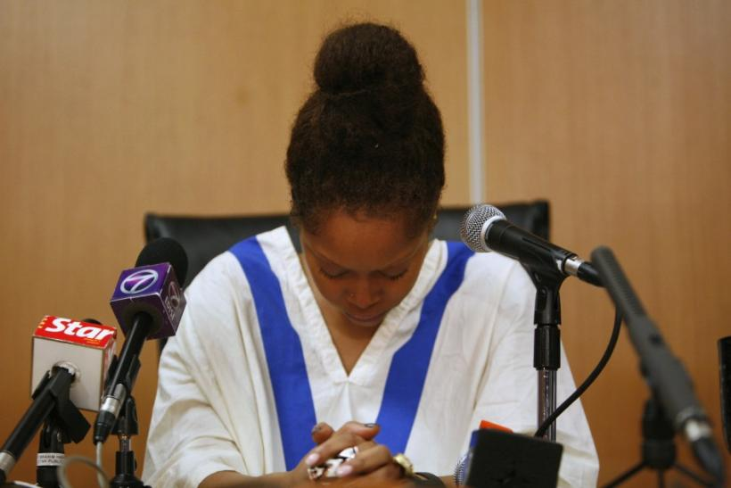 Badu cries during a news conference in Kuala Lumpur February 29, 2012