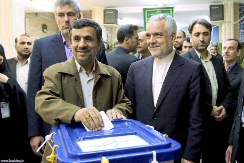 Iranian President Ahmadinejad casts his vote at a mosque, used as a polling station, during the parliamentary election in Tehran