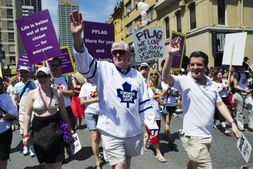 Maple Leaf's General Manager Brian Burke marches in the Toronto Gay Pride Parade in support of his son Brendan.