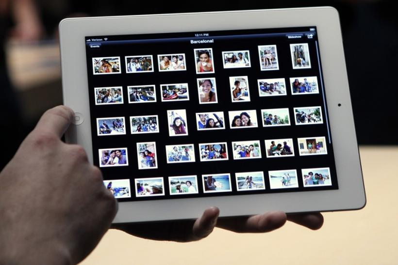 Guests preview the new iPad with the iPhoto application in the demonstration room after the Apple event in San Francisco