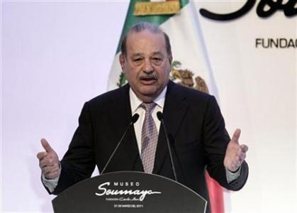 Mexican tycoon Carlos Slim speaks during the opening of the Soumaya museum in Mexico City March 1, 2011.