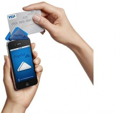 A PayPal Here device affixed to a mobile phone is demonstrated in a handout photo.