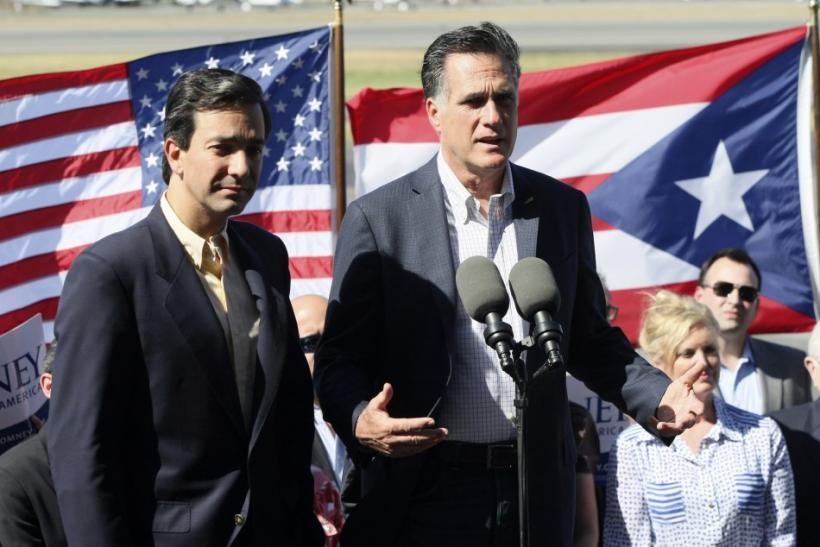 Mitt Romney addresses media next to Puerto Rico Gov. Luis Fortuño upon arrival at Isla Grande airport in San Juan March 16, 2012.