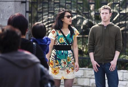 Facebook CEO Mark Zuckerberg (R) and his girlfriend Priscilla Chan walk near Fuxing Road in Shanghai March 27, 2012. Zuckerberg and his girlfriend were visiting Shanghai, according to local media reports. Picture taken on March 27, 2012.