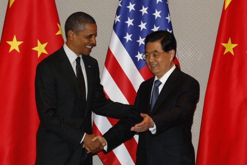 U.S. President Obama shakes hands with China's President Hu during expanded bilateral meeting in Seoul.